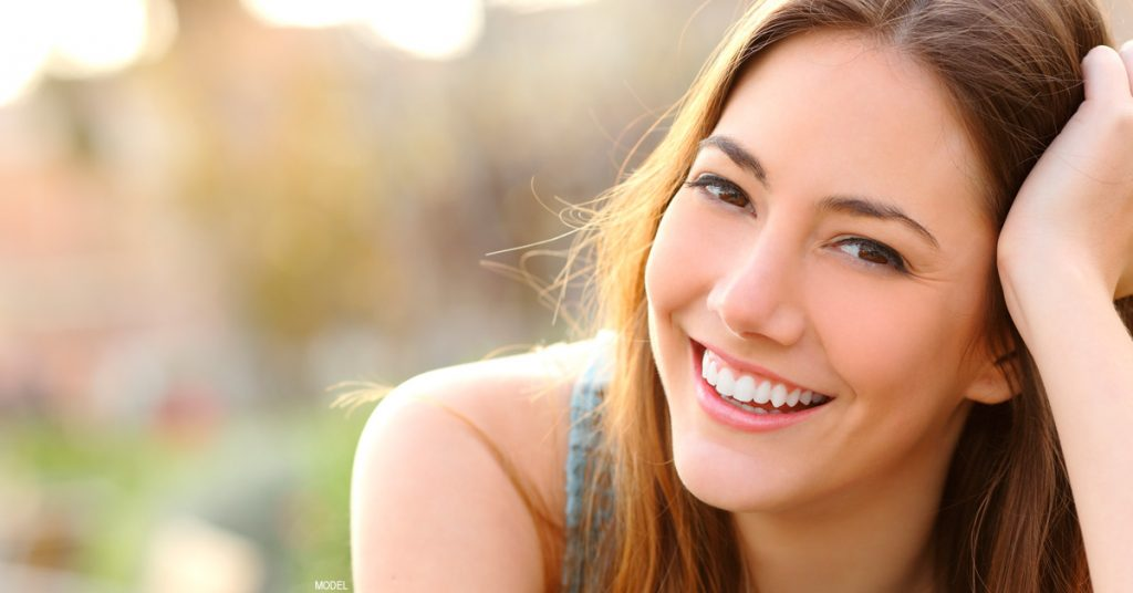 Woman smiling after rhinoplasty