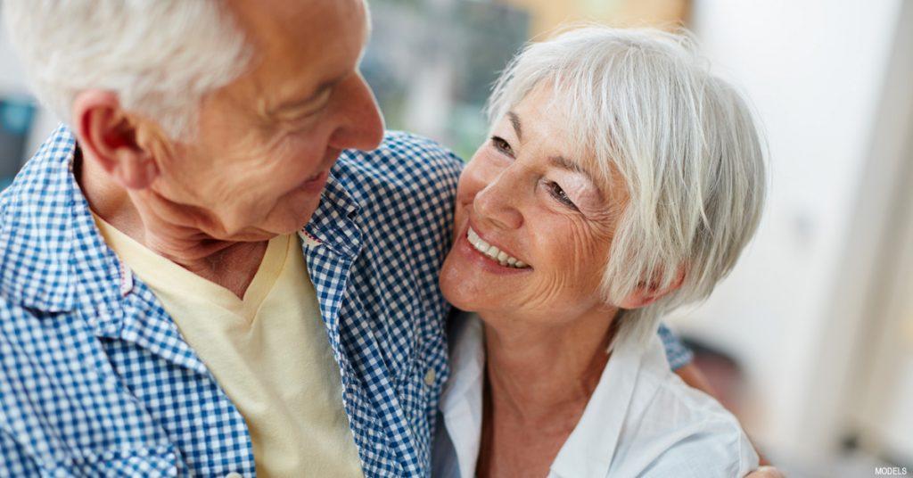 Older couple discussing eyelid surgery in Tucson, AZ
